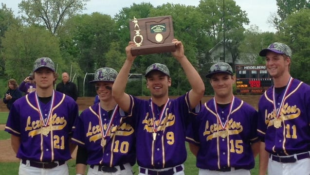 Lexington's team captains (left to right) Matt Frazier, Brady Kunkle, Joey Vore, Andrew Iten and Spencer Stierhoff, pose with D-II District Championship trophy on Saturday.