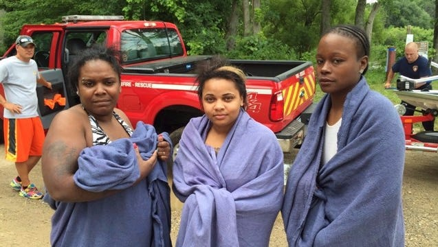 Three women have been rescued from the Muskegon River after being stranded overnight.