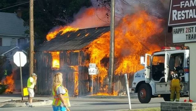Flames engulf a wooden barn in the 16000 block of Main Street in Spring Run the morning of Thursday, Sept. 8, 2016.