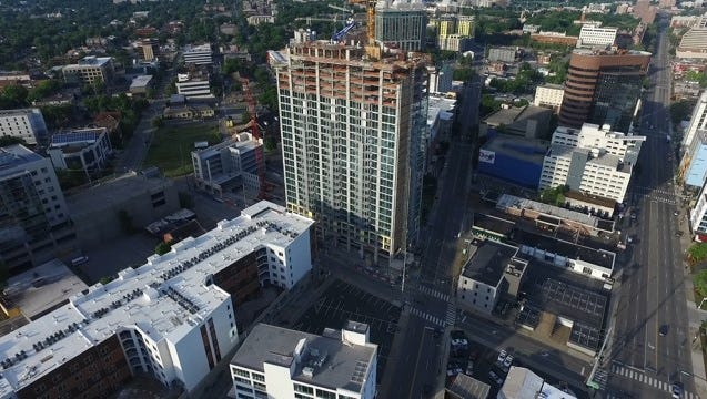 An aerial view of SkyHouse Nashville, which is nearing completion along Broadway, 17th Avenue and Division Street in Midtown.