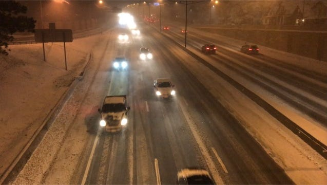 Drivers battle snow and scattered whiteout conditions local expressway.