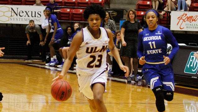 ULM's Carissa Moody dribbles the ball down court during Saturday's game.