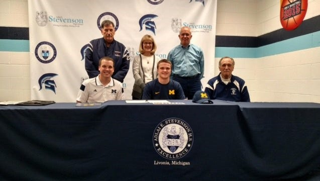 Livonia Stevenson pitcher Dan Bos (seated, center) is all smiles about signing to play baseball at University of Michigan-Dearborn. Also seated in the front row are Matt Cunningham (left), the new baseball coach at UMD and Stevenson baseball coach Rick Berryman. Standing (from left) are Glenn Scala, Debbie Bos and Brad Bos.