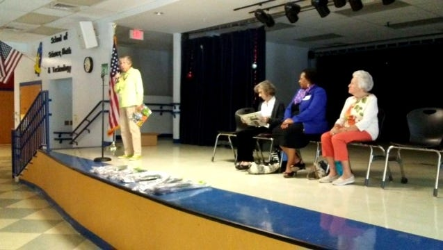 Pam Jacobsen, chair of the Woman's Club of Stuart's Conservation Committee, talks about Arbor Day at J.D. Parker Elementary with Montell Truitt, Eula Clark, Mary Harrell and Mona Salisbury.