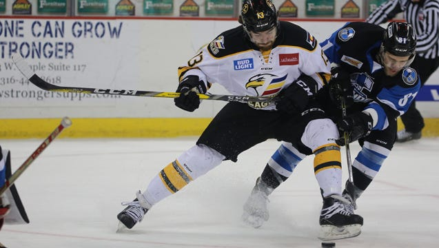 Colorado Eagles forward Kenny Brooks battles a Wichita defender for a puck last week. The Eagles won all three games of the series to extend their win streak to nine games.