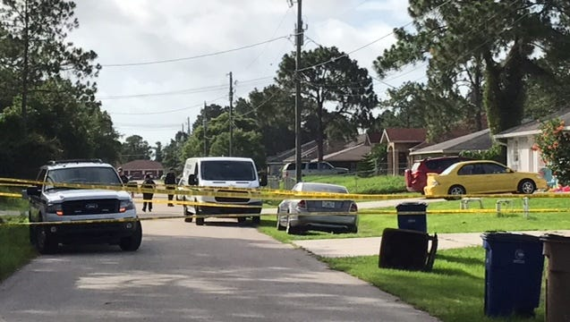 Crime tape cordons off a home on 4651 28th Street SW in Lehigh Acres where a father allegedly shot and killed his son on Monday.