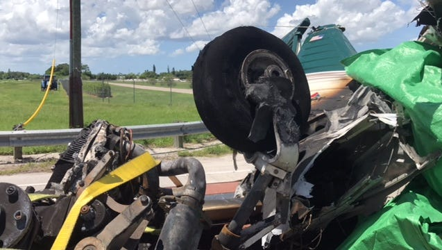 Wreckage from a plane that crashed off Metro Parkway on Saturday killing a passenger is moved by the National Transportation Safety Board to Page Field.