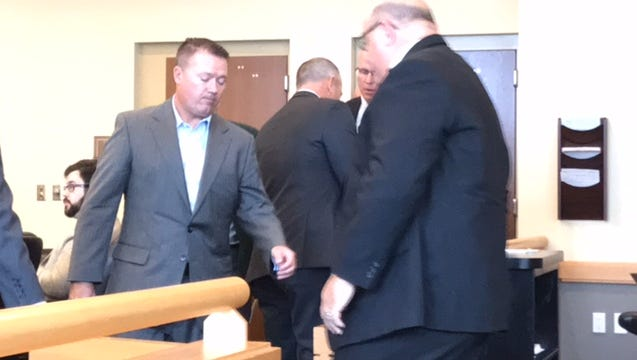 Suspect Adam Costello, left, during a pretrial hearing Tuesday.