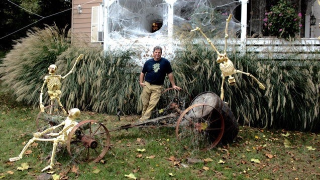 Jim Adams with this year's Halloween display.