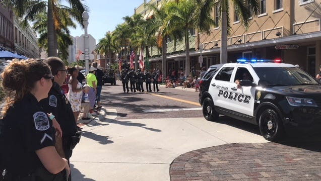 Fort Myers police officers, here shown at the 2018 Edison Junior Parade on Feb. 11, will be among the visible security measures at Saturday's 80th Grand Parade.