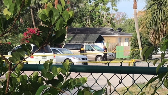 Lee County Sheriff's Office crime scene technicians look over a van parked at a home on Matheson Avenue in Bonita Springs where a homicide occurred late Saturday night. No details were available.