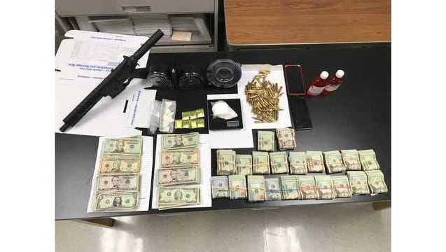 After searching an Opelousas home, deputies found drugs, a gun and $25,000 in cash.