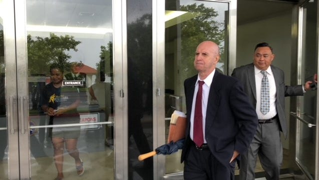 Attorney Michael Berman, left, counsel for nearly three dozen plaintiffs in clergy sex abuse cases, and Attorney Vincent Camacho, right, representing the Capuchin Franciscans, exit the U.S. District Court building Tuesday morning after a joint hearing on the status of 174 clergy sex abuse cases along with 10 abuse claims that don't involve lawsuits.