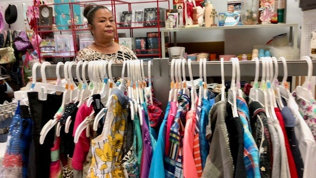 Archdiocese of Agana's Ministry to the Homeless Thrift Store program director Doris C. Royal shows some of the items at the thrift store in Hagatna, which will have its grand opening on Thursday, July 12.