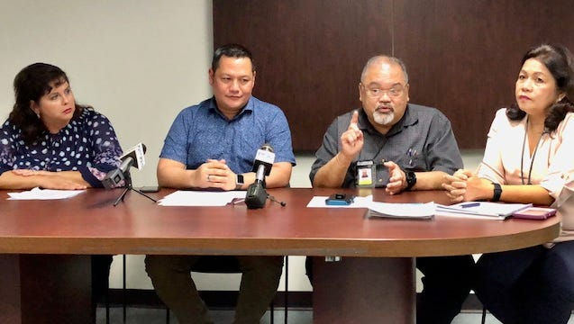 Guam Memorial Hospital Administrator PeterJohn Camacho, second from right, gestures as he talks about some $600,000 worth of medical equipment, during a July 26, 2018 news briefing by GMH and Guam Economic Development Authority. GEDA makes available to GMH $600,000 worth of community contributions from Guam Regional Medical City as a condition for its tax breaks under a qualifying certificate program.