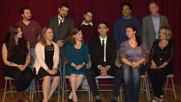 Bobby, center, played by Frank Falisi, is surrounded by the cast of Company, presented by Spotlight Players.