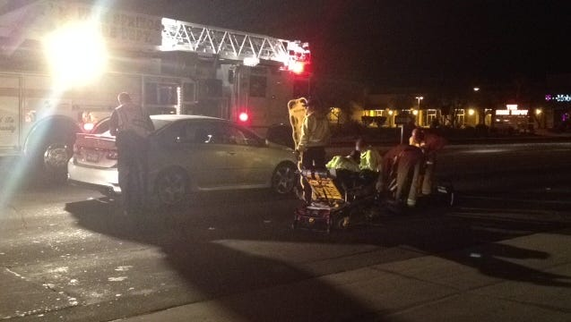 Firefighters help a woman who was hit by a car on Ramon Road in Palm Springs Saturday night.