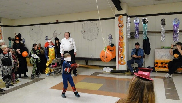 Fire Chief John Franz oversees the pinata at the Rome Halloween event.