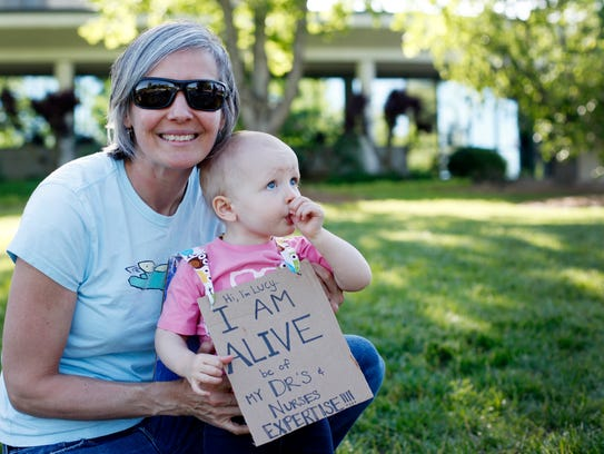 Laura Byrd with her daughter, Lucy, 18 months, at the