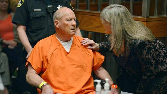 Public defender Diane Howard, right, speaks with Joseph James DeAngelo, 72, who authorities suspect is the so-called Golden State Killer responsible for at least a dozen murders and 50 rapes in the 1970s and 80s, as he makes his initial appearance, Friday, April 27, 2018, in Sacramento County Superior Court in Sacramento, Calif. (Randy Pench/The Sacramento Bee via AP)