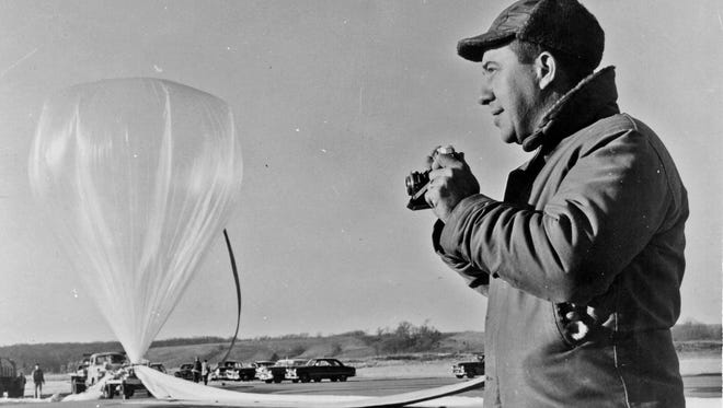 James Van Allen is seen at the Iowa City airport, circa 1951, conducting tests of high-altitude weather balloons and research equipment and telemetry.