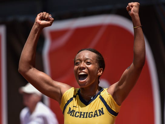University of Michigan's Brienne Minor celebrates her victory over Florida's Belinda Woolcock in the final match of the NCAA women's tennis championship Monday, May, 29, 2017, in Athens, Ga. (AP Photo/Richard Hamm)