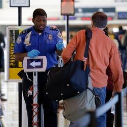 A TSA agent checks paperwork Nov. 21 at Midway International Airport.