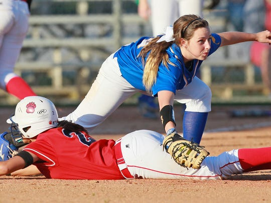 Wren's Savannah Huff applies a tag after Belton-Honea Path's Lexie Overmeyer returns safely to first after a line drive out during the top of the fourth inning at Wren High School in Piedmont.