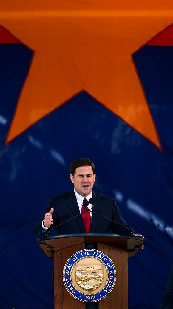 Doug Ducey gives a speech after being sworn in as the