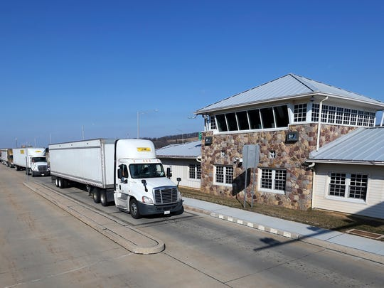 In this Monday, Feb. 6, 2017, photo, trucks line up to pass through the Greenwich truck weigh station on Interstate 78, in Greenwich Township, N.J. The New Jersey State Police operate the weigh station and often check contents of trucks and trailers. (AP Photo/Mel Evans)