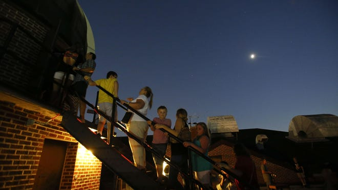 Members of the public enjoy a free view of the Moon and Saturn through the telescope in Gallalee Hall on the campus of the University of Alabama Wednesday, September 7, 2016.  Staff Photo/Gary Cosby Jr.
