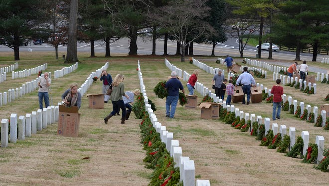 Volunteers place wreaths on the headstones at East Tennessee State Cemetery off Lyons View in 2015.