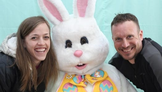 Mishicot dentists Erin Lasslo and Jason Thiel enjoy a moment with the Easter bunny at the third annual Easter egg hunt at the Mishicot VFW.