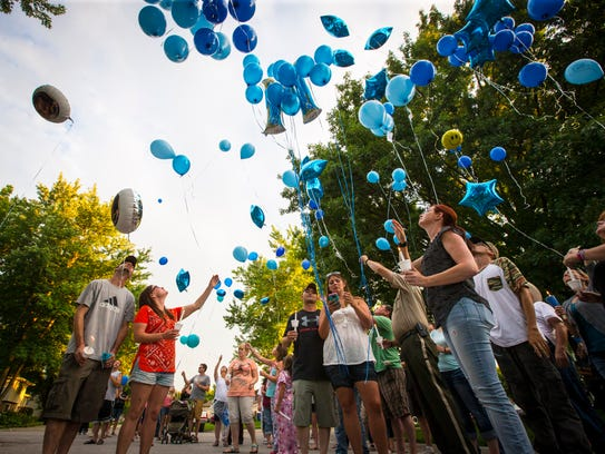 Balloons were released and a candlelight vigil was