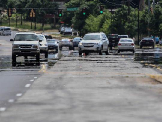 Heat rises off the asphalt near downtown Greenville,
