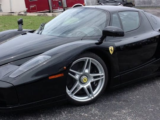 A 2003 model Ferrari is part of a U.S. Marshals auction in Miami.