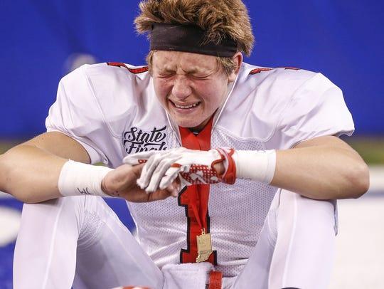 Center Grove Trojans' Jack Moore (1) sheds a tear as