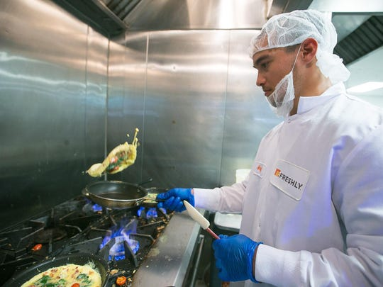 Angel Sanchez prepares omelets at Freshly, a meal-delivery