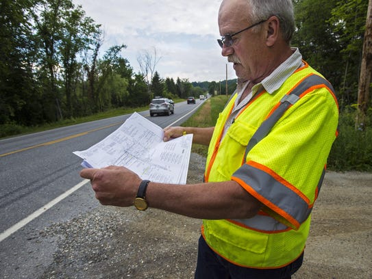 Joseph Depaolis of Boswell Engineering looks over plans