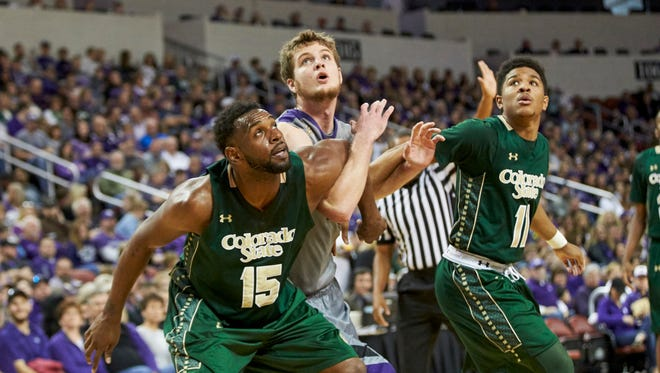 CSU's Tiel Daniels, left, and Prentiss Nixon box out a Kansas State player while eyeing a rebound in a Dec. 19 game in Wichita, Kansas.