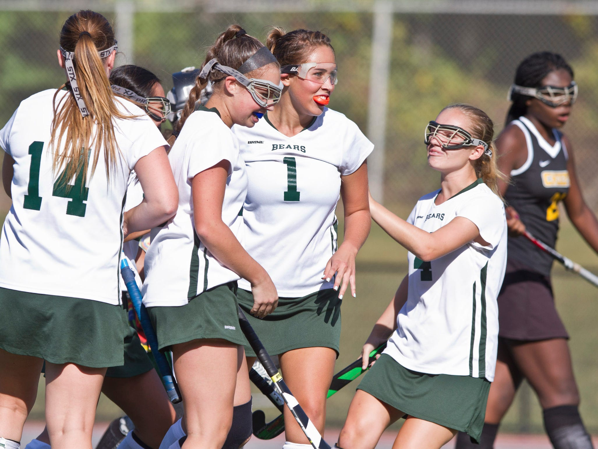 East Brunswick's Sydney Huang celebrates with teammates after scoring a goal. Piscataway vs East Brunswick field hockey. 72670492 East Brunswick, NJ Thursday, September 24, 2015 @dhoodhood