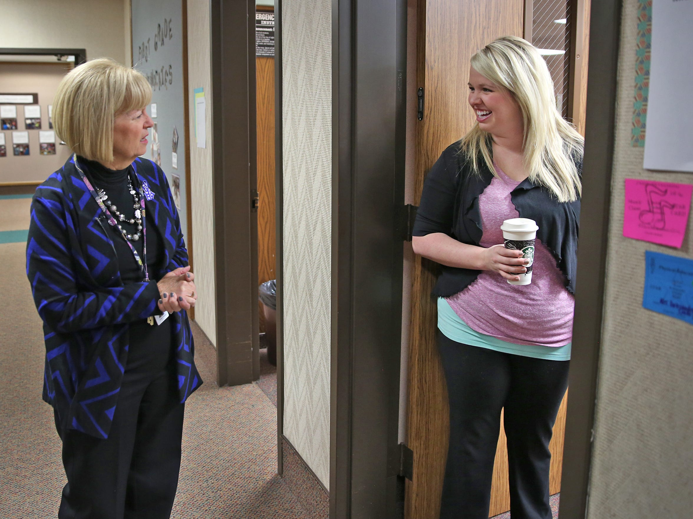 "Connie Thomas (left) starts her days at Amy Beverland Elementary by strolling the halls and talking with teachers, such as Lori Dalesandro, and arriving students. Thomas, who refers to herself as the ""guest principal,"" is filling in for Susan Jordan, the longtime principal who was killed in an accident at the school."