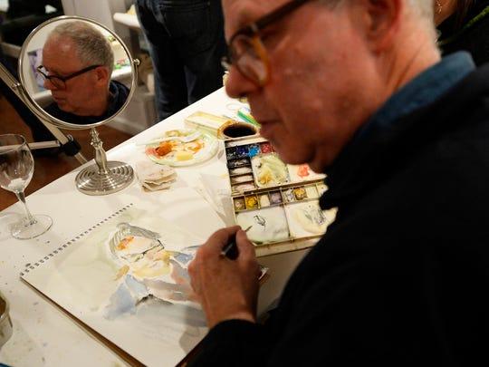 Peter Danko of York looks over at a fellow artists, whose portrait he was painting, during Le Petit Monster Drawing Rally at YorkArts in York Thursday, January 8, 2015.