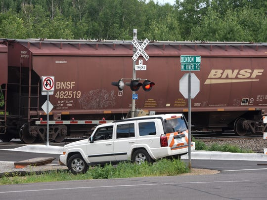 BNSF crews work at the intersection of Benton Drive and NE River Road Friday, July 14, north of Sartell.