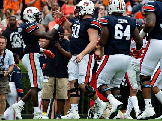 Auburn running back Kerryon Johnson (21) celebrates