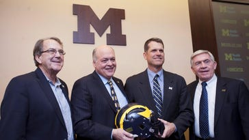 Harbaugh says Ford's Hackett 'makes great' calls