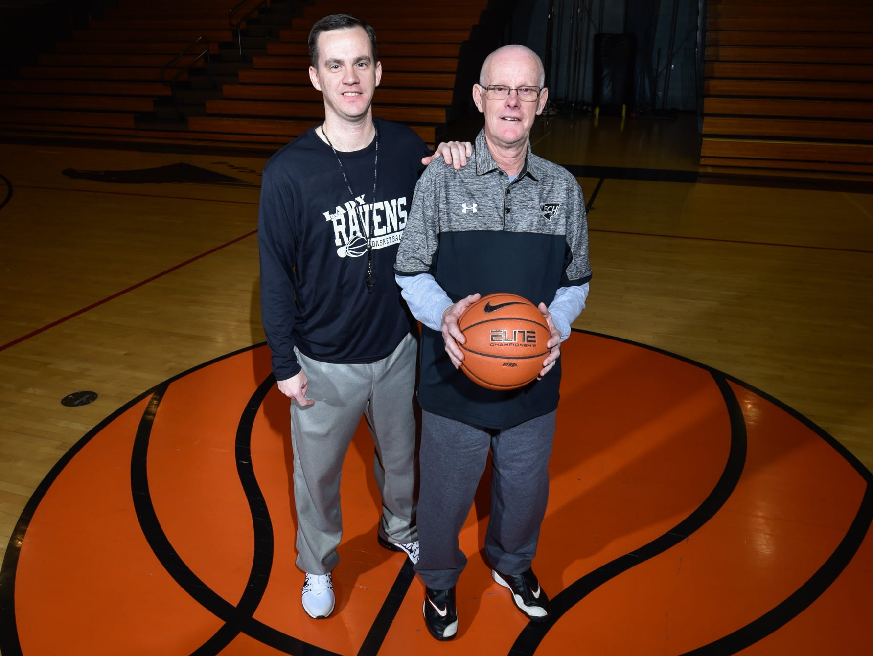 Sussex Tech girls basketball coach Chester Davis (right), who recently earned his 500th career coaching win, poses with his son Justin, a longtime assistant who will become the Ravens' head coach next season.