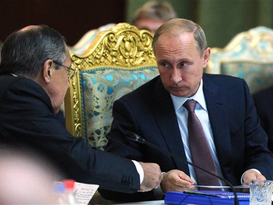 Russian President Vladimir Putin on Tuesday strongly defended Moscow's military assistance to the Syrian government, saying it's impossible to defeat the Islamic State group without cooperating with the Syrian government.