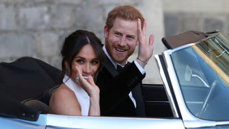 The newly married Duke and Duchess of Sussex, Meghan Markle and Prince Harry, leave Windsor Castle in a convertible after their wedding in Windsor, England.