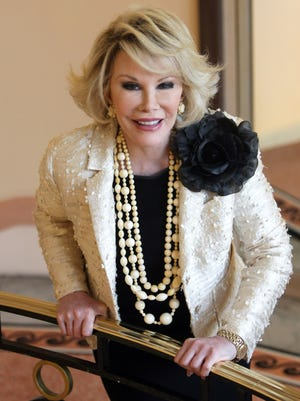 """Joan Rivers posing as she presents """"Comedy Roast with Joan Rivers """" during the 25th MIPCOM (International Film and Programme Market for TV, Video, Cable and Satellite) in Cannes, southeastern France. Rivers, the raucous, acid-tongued comedian who crashed the male-dominated realm of late-night talk shows and turned Hollywood red carpets into danger zones for badly dressed celebrities,  died Thursday, Sept. 4, 2014. She was 81. Rivers was hospitalized Aug. 28, after going into cardiac arrest at a doctor's office."""